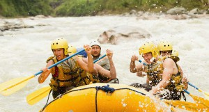 group of people white water wrafting